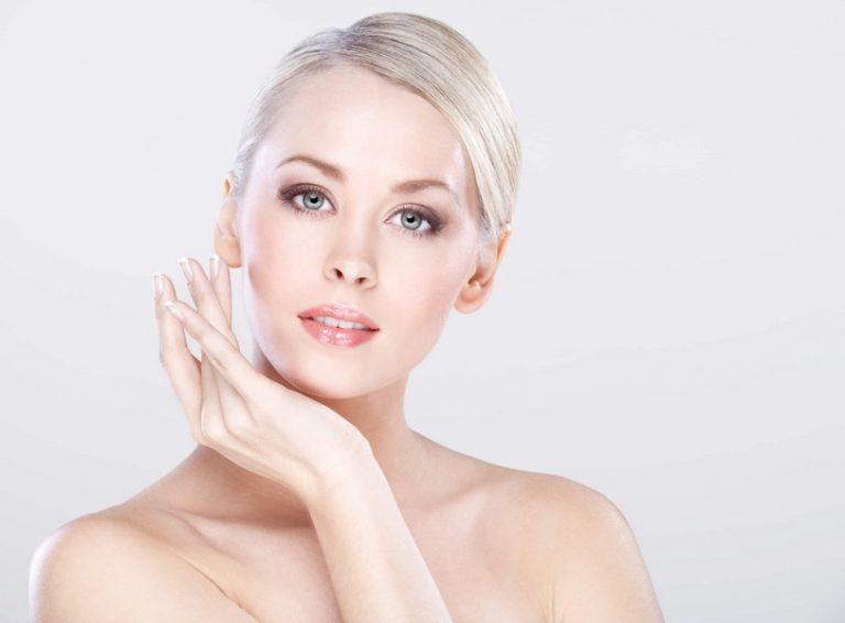 Young beautiful caucasian woman with natural makeup posing in the studio